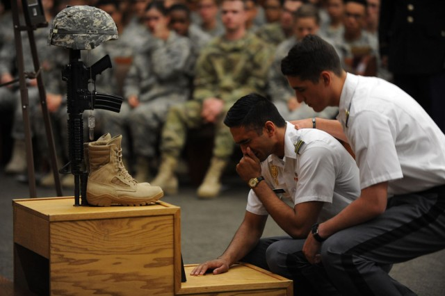 West Point Cadet James Manni, comforts Cadet Zain Shaikh during a tearful goodbye to his best friend and classmate Cadet Mitchell Winey at a memorial, June 9. Shaikh remembered his friend as someone who touched the lives of everyone he met.