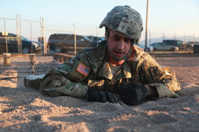 Sgt. Travis Wilt, assigned to 307th Expeditionary Signal Battalion, 311th Signal Command (Theater), crawls through an obstacle during an Obstacle Course event during the NETCOM Best Warrior Competition at Fort Huachuca, Arizona, June 13, 2016. The competition is a grueling week-long event that tests the skills, knowledge, and professionalism of 10 warriors representing NETCOM's subordinate organizations.