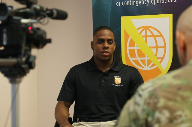 Spc. Samuel Latimore, assigned to the 52nd Signal Battalion and representing the 5th Signal Command (Theater), sits through a media interview during first day of the NETCOM 2016 Best Warrior Competition held at Fort Huachuca, Ariz., June 15, 2016. The competition is a grueling week-long event that tests the skills, knowledge, and professionalism of 10 warriors representing NETCOM's subordinate organizations.