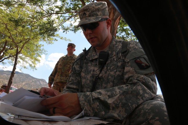 Sgt. Jeffery Lamb, assigned to 114th Signal Battalion and representing the 7th Signal Command (Theater), navigates his map during a scavenger hunt as part of NETCOM 2016 Best Warrior Competition at Fort Huachuca, Arizona, June 12, 2016.   The competition is a grueling week-long event that tests the skills, knowledge, and professionalism of 10 warriors representing NETCOM's subordinate organizations.
