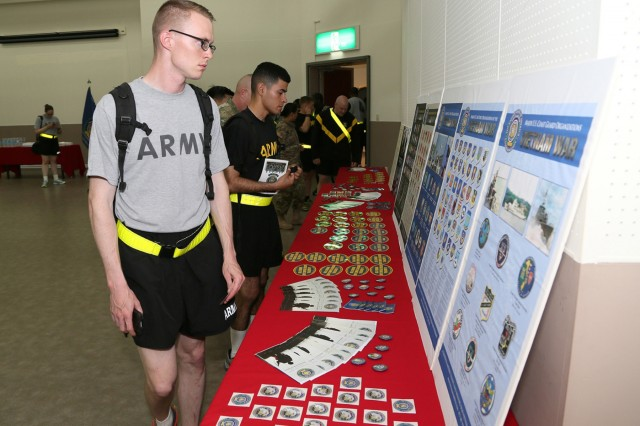 Soldiers and other audience members view Vietnam memorabilia on display at the Camp Zama Community Recreation Center during the annual Vietnam Commemoration Ceremony June 15, hosted by USAG Japan. (U.S. Army photo by Yuichi Imada)