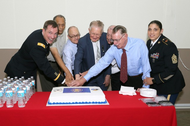 Col. William B. Johnson and Command Sgt. Maj. Rosalba Dumont-Carrion, commander and command sergeant major of USAG Japan, respectively, and Vietnam veterans, including Lt. Col. (Retired) Robert E. Gordon, guest speaker, cut the ceremonial cake during the reception after USAG Japan's annual Vietnam Commemoration Ceremony held June 15 at the Camp Zama Recreation Center. (U.S. Army photo by Yuichi Imada)