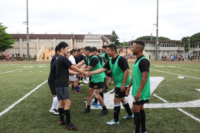 JGSDF members, left, and Soldiers, right, greet one another before their soccer match June 17 during Camp Zama's Army Birthday Week celebration, hosted by USARJ. (U.S. Army photo by Lance D. Davis)