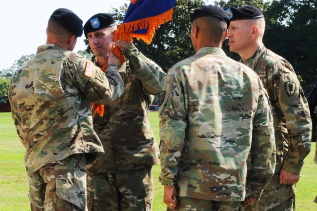 Lt. Col. Kevin E. McHugh, 1st Battalion, 13th Aviation Regiment commander, receives the colors from Col. Woodard B. Hopkins, 1st Aviation Brigade commander, as he assumes command during a ceremony June 10.