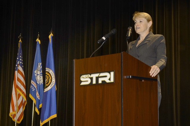 The Honorable Katrina McFarland, acting Assistant Secretary of the Army (Acquisition, Logistics and Technology) and Army Acquisition Executive, addresses the attendees at the change of charter ceremony for the Program Executive Office for Simulation, Training and Instrumentation.