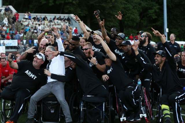Team Army celebrates the opening of the 2016 Department of Defense Warrior Games with comedian, Jon Stewart, after the opening ceremony in Shea Stadium, United States Military Academy, at West Point, New York, June 15. (U.S. Army Photo by Pfc. Stefan English/Released)
