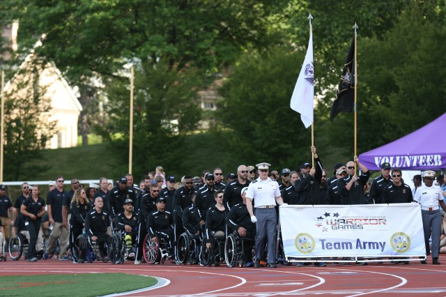 Team Army marches into Shea Stadium during the opening ceremony for the 2016 Department of Defense Warrior Games at the United States Military Academy, at West Point, New York, June 15. (U.S. Army Photo by Pfc. Stefan English/Released)