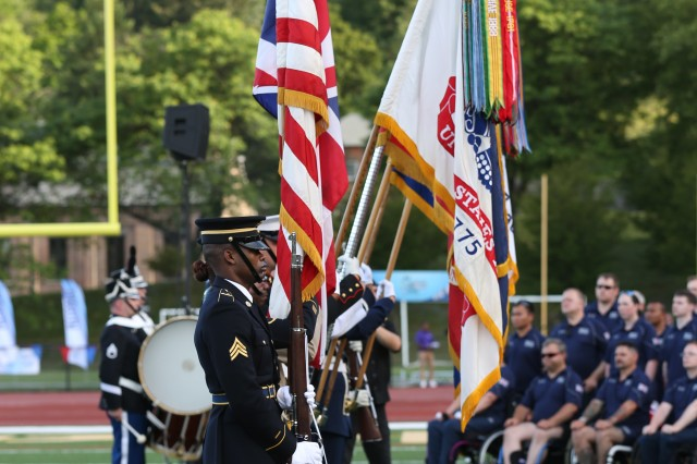 The Color Guard presents the colors during the National Anthem for the for 2016 Department of Defense Warrior Games opening ceremony, in Shea Stadium, at the United States Military Academy, at West Point, New York, June 15. (U.S. Army Photo by Pfc. Stefan English/Released)