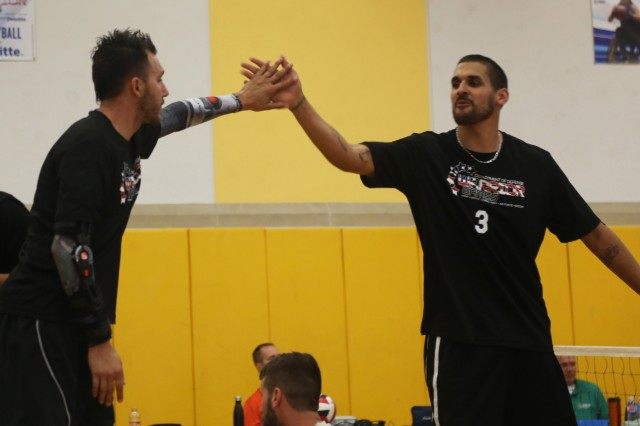 U.S Army Veteran, Sgt. Robbie Gaupp, of Gatesville, Texas, and U.S. Army Veteran, Spc. Dustin Barr, of Jamseville, North Carolina, celebrate after their teammates scored a point during a sitting volleyball match in the 2016 Department of Defense Warrior Games, in Arvin Gym, at the United States Military Academy, at West Point, New York, June 15. (U.S. Army Photo by Pfc. Stefan English/Released)