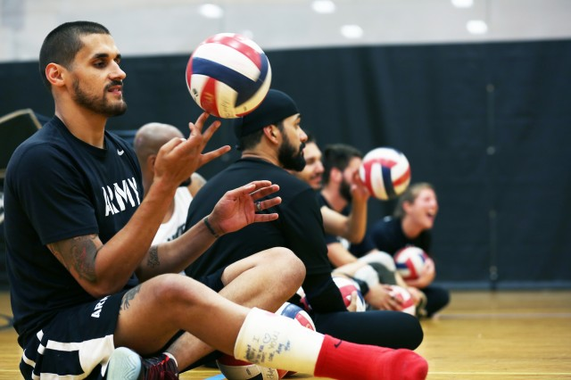 U.S. Army Veteran, Spc. Dustin Barr, of Jamesville, North Carolina, prepares for volleyball training at Arvin Gym, in preparation for the 2016 Department of Defense Warrior Games at the United States Military Academy, West Point, New York, June 11, 2016. The DoD Warrior Games, June 15-21, is an adaptive sports competition for wounded, ill and injured service members and Veterans. Athletes representing teams from the Army, Marine Corps, Navy, Air Force, Special Operations Command, and the United Kingdom Armed Forces compete in archery, cycling, track, field, shooting, sitting volleyball, swimming, and wheelchair basketball. (U.S. Army photo by Spc. Michel'le Stokes/Released)