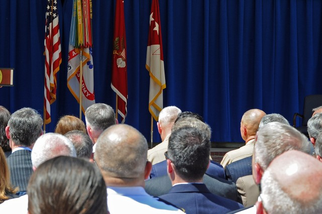 Army Secretary Eric Fanning addresses a large Pentagon audience as Army Chief of Staff Gen. Mark Milley looks on. The secretary and chief celebrated the Army's 241st birthday with a cake-cutting June 17, 2016.
