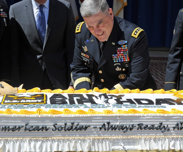 CSA Slicing Through 241st Birthday Cake
