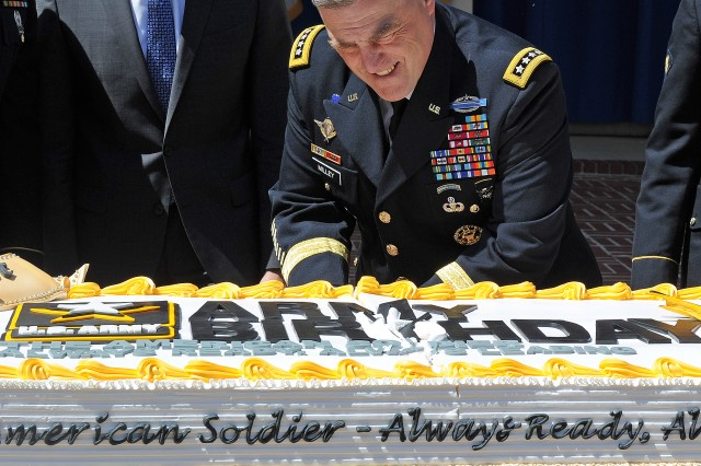 Following the initial group slice, Army Chief of Staff Gen. Mark Milley takes the broad steel of the sabre to the bottom of the cake in a ceremony at the Pentagon honoring the Army's 241st birthday at the Pentagon June 17, 2016.
