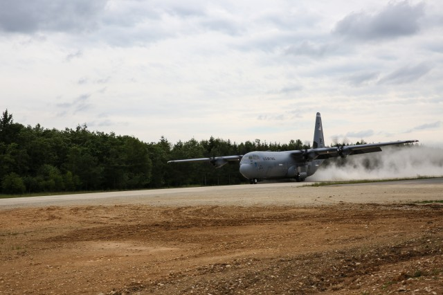 A U.S. Air Force Lockheed C-130 Hercules of 317th Airlift Group taxis on the Joint Multinational Readiness Center's (JMRC) Short Takeoff and Landing Strip while conducting Air-Land operations to establish a lodgement during Swift Response 16 training exercise at the Hohenfels Training Area, a part of the JMRC, in Hohenfels, Germany, Jun. 16, 2016. Exercise Swift Response is one of the premier military crisis response training events for multi-national airborne forces in the world. The exercise is designed to enhance the readiness of the combat core of the U.S. Global Response Force -- currently the 82nd Airborne Division's 1st Brigade Combat Team -- to conduct rapid-response, joint-forcible entry and follow-on operations alongside Allied high-readiness forces in Europe. Swift Response 16 includes more than 5,000 Soldiers and Airmen from Belgium, France, Germany, Great Britain, Italy, the Netherlands, Poland, Portugal, Spain and the United States and takes place in Poland and Germany, May 27-June 26, 2016. (U.S. Army photo by Spc. Lloyd Villanueva)