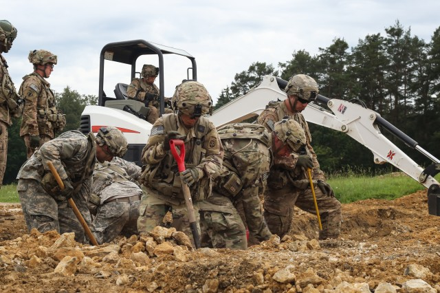 U.S. Soldiers of Bravo Company, 127th Brigade Engineer Battalion, 82nd Airborne Division clear a crater in a simulated landing strip while conducting a quick airstrip repair scenario during Swift Response 16 training exercise at the Hohenfels Training Area, a part of the Joint Multinational Readiness Center, in Hohenfels, Germany, Jun. 16, 2016. Exercise Swift Response is one of the premier military crisis response training events for multi-national airborne forces in the world. The exercise is designed to enhance the readiness of the combat core of the U.S. Global Response Force -- currently the 82nd Airborne Division's 1st Brigade Combat Team -- to conduct rapid-response, joint-forcible entry and follow-on operations alongside Allied high-readiness forces in Europe. Swift Response 16 includes more than 5,000 Soldiers and Airmen from Belgium, France, Germany, Great Britain, Italy, the Netherlands, Poland, Portugal, Spain and the United States and takes place in Poland and Germany, May 27-June 26, 2016. (U.S. Army photo by Sgt. Alexandra Hulett)