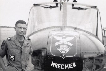 Maj. Charles Kettles stands in front of a 121st Aviation Company, UH-1H helicopter, during his second tour of duty in Vietnam in 1969. During his first tour with the 176th Aviation Company in May 1967, Kettles saved eight Soldiers who had been left behind after an initial rescue mission. He then managed to pilot the severely overloaded helicopter to safety and will be awarded the Medal of Honor in a July White House ceremony.