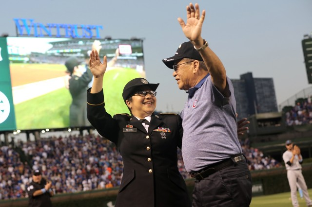 Army Reserve Sgt. 1st Class Susan Torres receives an on-field recognition, with her father, Richard Mejia, Vietnam Veteran and Purple Heart recipient, during a Father's Day Military Salute at the Chicago Cubs vs Pittsburgh Pirates game at Wrigley Field, June 19, 2016. Torres threw out a ceremonial first pitch and was recognized, on the field, during the fourth inning in front of an audience of more than 41,000. (U.S. Army photo by Sgt. 1st Class Anthony L. Taylor/Released)