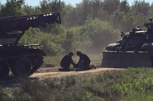 As part of a multinational recovery exhibition, these Polish Soldiers from the 3rd Surface to Air Missile Brigade demonstrate how to recovery one of their primary air defense assets.