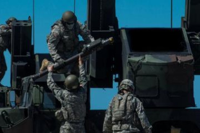 Just moments before the Avenger Stinger live fire event, the Soldiers from the 174th Ohio National Guard Air Defense Artillery Brigade load their Avengers with their Stinger missiles.