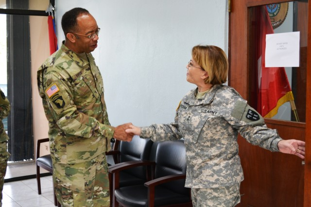 Maj. Gen. Marta Carcana the adjutant general of the Puerto Rico National Guard, greets Maj. Gen. A.C. Roper, commander of the 80th Training Command, at Fort Allen, Puerto Rico March 10, 2016. Roper met with Carcana to discuss the ongoing relationship between the Puerto Rico National Guard and 5th Brigade 94th Training Division, an 80th TC subordinate unit.