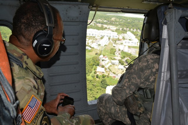 Maj. Gen. A.C. Roper, commander of the 80th Training Command, observes the Puerto Rican landscape from a UH-60 Black Hawk helicopter during a visit to Puerto Rico and St. Croix, March, 10, 2016. During his visit, Roper met with the National Guard adjuvants general of the two islands to discuss the ongoing relationship between the National Guard and 5th Brigade 94th Training Division, an 80th TC subordinate unit.