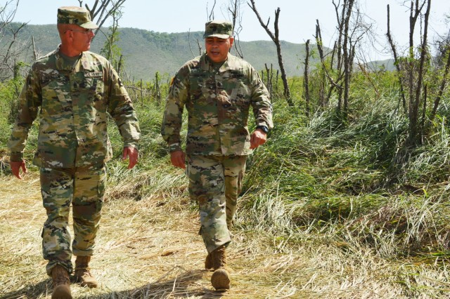 Command Sgt. Maj. Jeffrey Darlington, senior noncommissioned officer 80th Training Command, interacts with his counterpart at 5th Brigade 94th Training Division, in Puerto Rico, March 10, 2016. Darlington visited the unit with Maj. Gen. A.C. Roper, commander 80th Training Command.