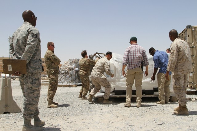 Soldiers, Marines, and Airmen work together to ensure airlift safety of a shipment from the Iraq Train and Equip Funding, May 21st, 2016. Once vetted through the Army movement combat team, the equipment is delivered to the Air Force for mobility into the areas of operation where ISF can then employ, as necessary, to counter ISIL as they work to regain territory from the terrorist group.