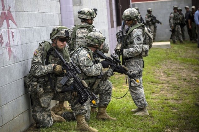 In October 2015, Soldiers from 3rd Brigade, 3rd Infantry Division, take enemy fire as they prepare to enter and clear a building during the live training at McKenna Urban Operations Complex at Fort Benning.