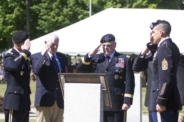 From left, Brig. Gen. Paul Bontrager, 10th Mountain Division (LI) and Fort Drum acting senior commander; retired Col. Michael Plummer, president of the National Association of the 10th Mountain Division; Army Chief of Staff Gen. Mark A. Milley; retired Command Sgt. Maj. Frank Grippe, former U.S. Central Command senior enlisted adviser; and Command Sgt. Maj. Charles W. Albertson, 10th Mountain Division (LI) senior enlisted adviser, salute a plaque bearing the names of the two 10th Mountain Division Soldiers who died last year in service to their nation, during Fort Drum's annual Mountain Remembrance ceremony Tuesday in Memorial Park.