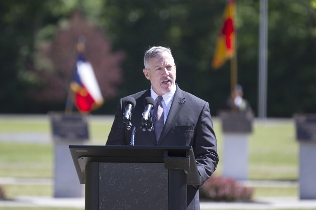 Retired Command Sgt. Maj. Frank Grippe, former U.S. Central Command senior enlisted adviser, speaks during Fort Drum's annual Mountain Remembrance ceremony Tuesday in Memorial Park.