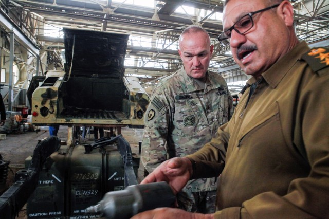 Chief Warrant Officer 3 Randy Growall, left, attached to the 300th Sustainment Brigade, observes a maintenance procedure during his visit to an Iraqi army small-wheel depot June 9, 2016, near Camp Taji, Iraq. Soldiers on such missions could be assigned to train-advise-and-assist brigades in the future. These brigades would have no junior Soldiers unless filled with trainees during a pending crisis, said Chief of Staff of the Army Gen. Mark Milley.