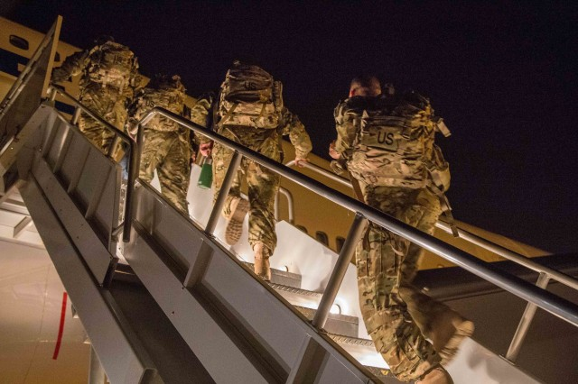 "Soldiers from the 36th Infantry Division, Texas Army National Guard, climb the gangway as they deploy to southern Afghanistan June 11, out of Fort Hood, Texas. They will be joining Task Force Arrowhead as part of the ""train, advise and assist"" team whose mission is to work with Afghan National Defense and Security Forces. In the future, TAA Brigades may only be composed of officers and NCOs, said the Army's chief of staff. (U.S. Army photo by Maj. Randall Stillinger, 36th Infantry Division Public Affairs)"
