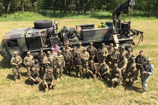 "The Bravo Company ""Bandits"" of the 173rd Brigade Support Battalion (Airborne), of the 173rd Airborne Brigade worked side-by-side with their Polish allies to recover mud-lodged American equipment during Anakonda 2016 in Biedrusko, Poland June 8, 2016. The Paratroopers and Polish recovery personnel worked together using each other's equipment to recover the equipment and used the opportunity to familiarize with each other's recovery techniques."
