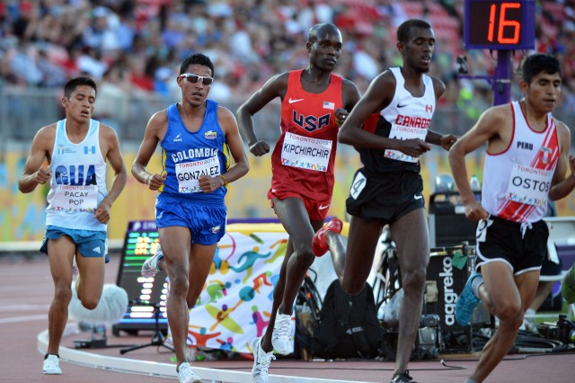 Spc. Shadrack Kipchirchir (center in red), seen here running at the 2015 Pan American Games in Toronto, is scheduled to run both the 10,000 meters and the 5,000 meters at the 2016 U.S. Olympic Track & Field Trials, set for July 1-10 at Hayward Field in Eugene, Oregon. U.S. Army photo by Tim Hipps, IMCOM Public Affairs