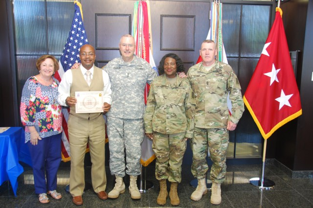 Lt. Gen. Michael Tucker, First Army commanding general, center, recognized more than 20 spouses of First Army Soldiers and civilians during a ceremony at First Army headquarters, June 21, on the Rock Island Arsenal, Illinois. Standing with Lt. Gen. Tucker includes his wife, Teresa, far left, and First Army Command Sgt. Maj. Sam Young, far right. Receiving a military spouse appreciation certificate is Stephen Brackett, spouse of Chief Warrant Officer 5 Cindy Frazier.