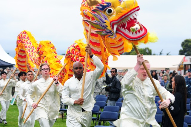 "PRESIDIO OF MONTEREY, California -- Students make their way through the crowd en route to perform a Chinese dragon dance on the main stage during the DLIFLC Language Day May 13, 2016. Photo by Steven L. Shepard, Presidio of Monterey PAOMore info: Thousands turned out for demonstrations of Palestinian fashion, Korean fan dancing, Russian pop music and other global cultural traditions during the Defense Language Institute Foreign Language Center's Language Day May 13, 2016 at the Presidio of Monterey. The annual event supports the military language school's motto: ""Peace through understanding,"" underscoring the importance of language education for thousands of high school students every year."