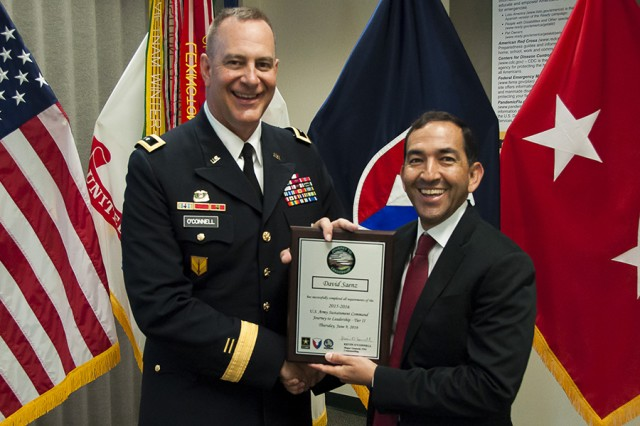 Maj. Gen. Kevin O'Connell, commanding general, U.S. Army Sustainment Command, presents David Saenz, Logistics Readiness Center-Carson, with a plaque following his graduation from Journey to Leadership Tier II at Rock Island Arsenal, Illinois, June 9. (Photo by Kevin Fleming, ASC Public Affairs)
