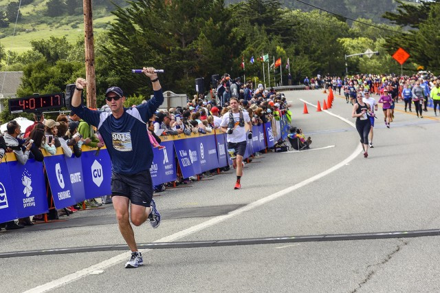 CARMEL, California -- Dozens of military-affiliated runners registered for the 2016 Big Sur International Marathon and several shorter races that took place April 24. The course, which is a Boston Marathon qualifier, is considered one of the world's most scenic marathon routes. Here, Air Force Col. Keith Logeman, U.S. Air Force 517th Training Group commander and Defense Language Institute Foreign Language Center assistant commandant, completes the final leg for the unit relay team. Other members of the team: Lt. Col. Allison Galford, Chief Master Sgt. Jason Aleksa, and Capt Alex Crandall. The team finished the relay with a chip time of 3:55:14.