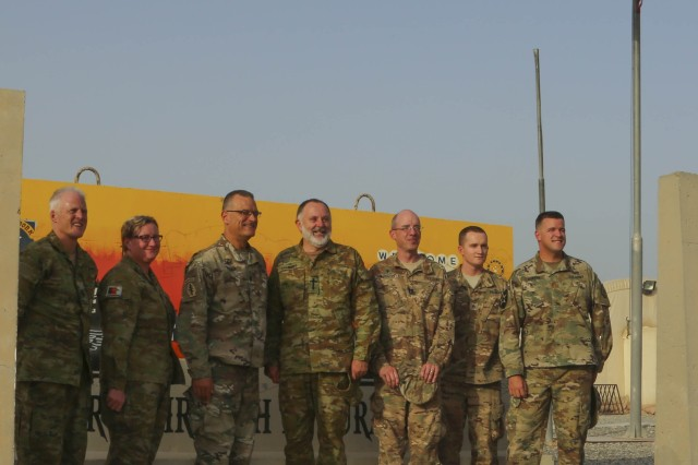 Bishop Ian Lambert (center), the Anglican Bishop to the Australian Defense Force, is flanked by two U.S. Army Anglican chaplains, Chaplain (Lt. Col.) Dan Knaup (third from left) with 335th Signal Command and Chaplain (Capt.) Ian Burgess (third from the right) with the 17th Sustainment Brigade, 1st Sustainment Command (Theater), who are stationed at Camp Arifjan, Kuwait on June 10, 2016. Connected by their convictions, the Anglican ministers freely discussed the challenges and rewards of being a military chaplain, how the chaplain corps is structured in their respective countries, and methods of Soldier care.