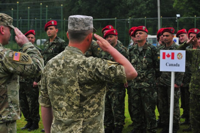 Co-Directors of Rapid Trident 16, U.S. Army Col. Nick Ducich (left) and Ukraine Army Col. Eduard Moskalyov (right), welcome the Canadian contigent, June 27, in Ukraine. Exercise Rapid Trident is an annual multinational training exercise series held in Ukraine. It is designed to enhance joint combined interoperability between Ukraine, the United States, NATO allies, and other Partnership for Peace nations.