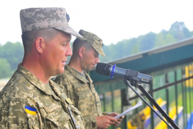 Co-director of Rapid Trident 16, Ukraine Army Col. Eduard Moskalyov, welcomes participants from 13 nations to the annual exercise, June 27, in Ukraine. Exercise Rapid Trident is an annual multinational training exercise series held in Ukraine. It is designed to enhance joint combined interoperability between Ukraine, the United States, NATO allies, and other Partnership for Peace nations.