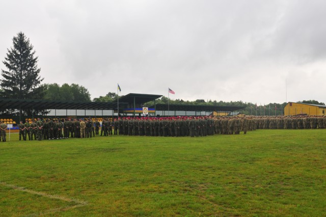 YAVORIV, Ukraine--Soldiers from thirteen different countries form-up for the opening ceremony of Rapid Trident 16, June 27, in Ukraine. Exercise Rapid Trident is an annual multinational training exercise series held in Ukraine. It is designed to enhance joint combined interoperability between Ukraine, the United States, NATO allies, and other Partnership for Peace nations.