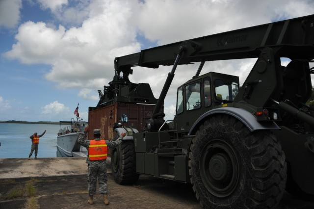 The 390th SPOC Soldiers moved 11,000-pound containers onto the LCM by utilizing a Rough Terrain Container Handler (RTCH).