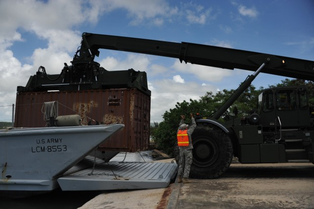 The 390th SPOC Soldiers moved 11,000-pound containers onto the LCM by utilizing a RTCH.