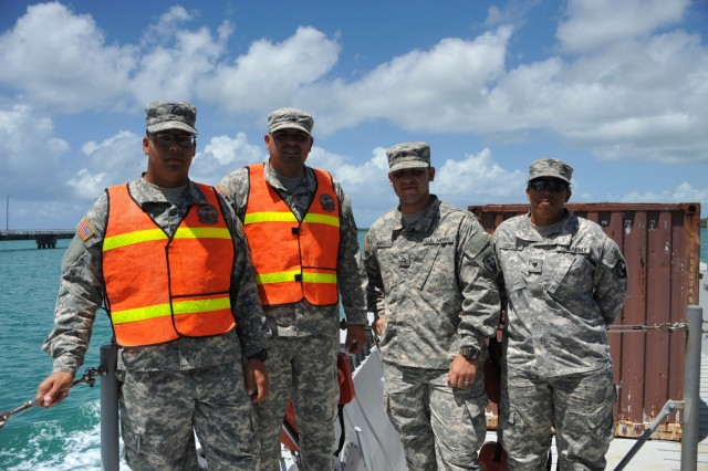 The 390th SPOC Soldiers getting a ride on the LCM brought by the Puerto Rico Army National Guard, LCD.