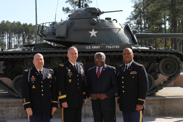 U.S. Rep. James E. Clyburn (SC) poses with U.S. Army Central soldiers (left to right) Col. Wayne Marotto, USARCENT chief of Public Affairs, Brig. Gen. David Glaser, USARCENT chief of staff, and Lt. Col. Tony Perry, USARCENT equal opportunity officer, prior to the Black History Month program Feb. 18, at Patton Hall.