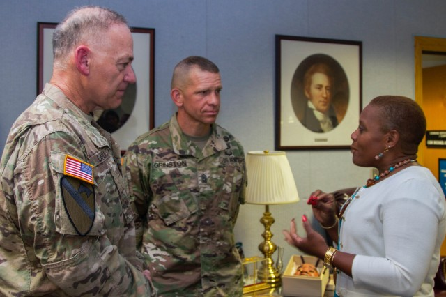 Monique Ferrell (right), sexual harassment and assault response program director, speaks with Lt. Gen. Stephen Lanza (left) and Command Sgt. Maj. Michael Grinston (center), I Corps commanding general and command sergeant major, June 23 at Joint Base Lewis-McChord, Washington. Ferrell was visiting to speak with squad leaders participating in the Not in My Squad workshop. The workshop focused on identifying ways to end sexual violence in the Army. Not in my squad is a grassroots initiative, focused at building mutual trust and cohesion at the squad and team level. (Photo by Staff Sgt. Bryan Dominique