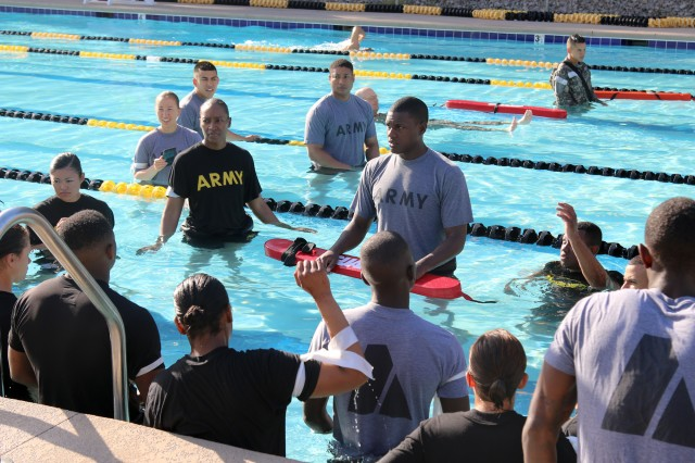 2nd Lt. Michael Davis (center), a quartermaster officer with the 127th Quartermaster Company, 3rd Expeditionary Sustainment Command, asks Soldiers to identify if they are weak swimmers during water survival training June 1 at Atchley Pool on Fort Bragg.