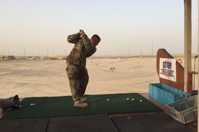 Maj. Tim Jenkins drives a golf ball at a range in Kuwait. From there, he is recruiting volunteers to help with the Bridgestone Invitational in Ohio.
