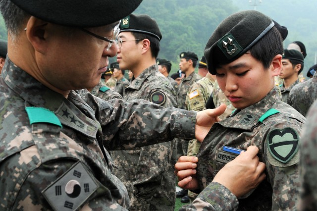 First Lieutenant Jung, Ji Eun, a platoon leader from the Republic of Korea (ROK) Army 115th Mechanized Infantry Battalion, 90th Mech. Inf. Brigade, 30th Mech. Inf. Division is pinned with the U.S. Expert Infantry Badge (EIB) by Maj. Gen. Cho, Han Gyu, the commander of the 30th Mech. Inf. Div. May 26 at Camp Casey, South Korea. Jung was the first female officer from South Korea to earn the U.S. Army EIB.